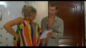 man boy a young Unbuttons her shirt to bra